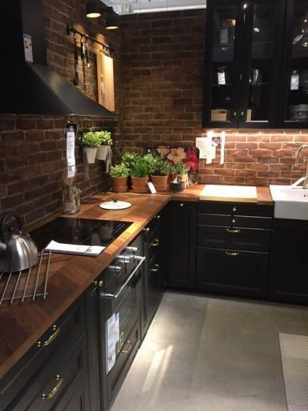 cocina moderna con muebles oscuros - Casa Web