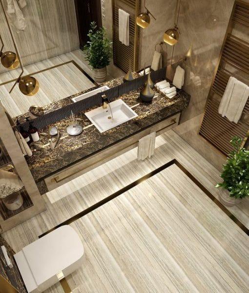 baños de lujos en tonos dorados y marron
