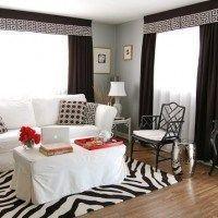 sala de estar sillon blanco coritnas negras