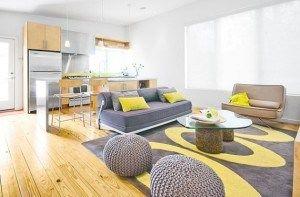 decorar living gris y amarillo