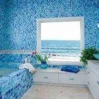 baño con venecitas en tonos celestes