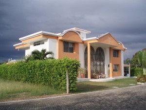 casa naranja y banca
