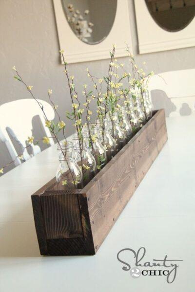 Centro de mesa con botellas de vidrio casa web for Centros de mesa para casa