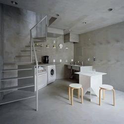 cocina duplex revestida con cemento alisado