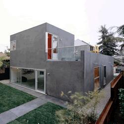 exterior casa revestido con cemento alisado