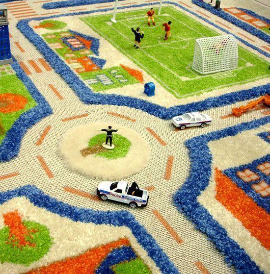 alfombra infantil con diseño de ciudad