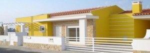 casa amarilla conbinada con revestimiento en piedras