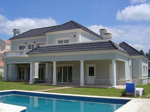 Casa celeste con tejas azules casa web for Pintura para exteriores de casa 2016