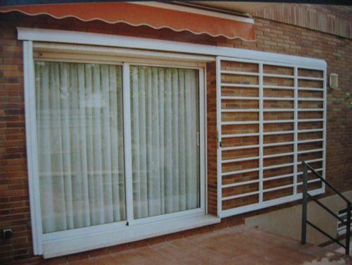 Ventanales de casas modernas casa web for Puerta ventana de aluminio corrediza