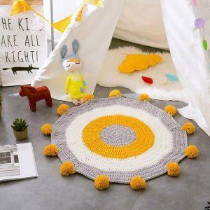 alfombra tejida para chicos playroom