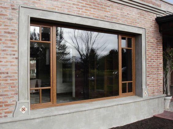 fachada de casa con ladrillo visto y cemento