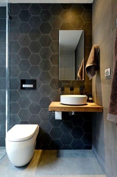 baño con ceramicas grises de distintas formas