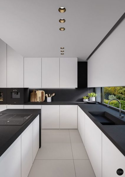 cocina blanca moderna con mesada negra