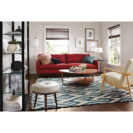 living blanco y negro con sofa rojo