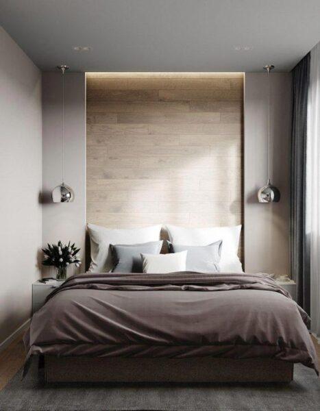 dormitorio con luz de acento en respaldo de cama