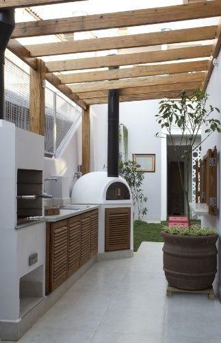 patio pequeño con asador