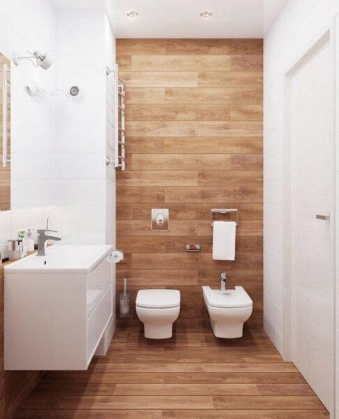 Baño revestido con vinilo simil madera