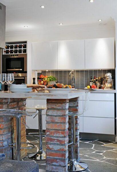 mesa para desayunar de concreto y ladrillo