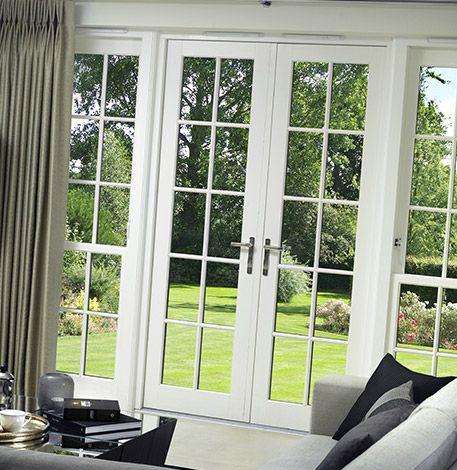 Ventanales abatibles estilo puerta francesa vidrio repartido