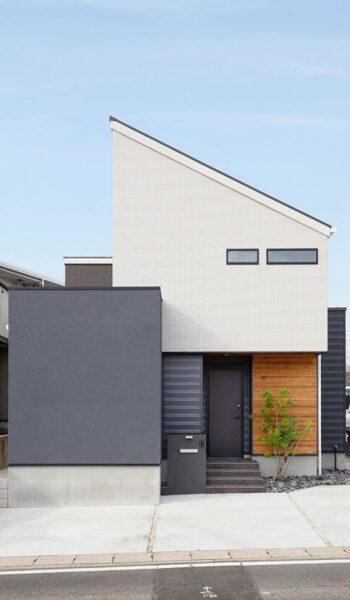 fachada de casa pequena de dos pisos