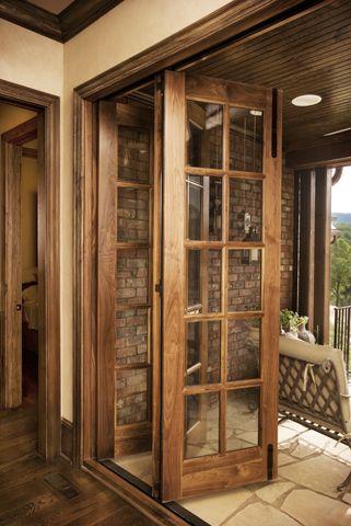 ventanal plegable de madera vidrio repartido